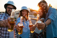 Happy cheerful friends spending fun times together Stock Photo