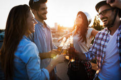 Happy cheerful friends spending fun times together. And drinking Royalty Free Stock Photos