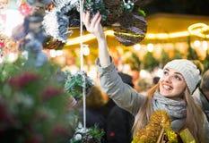 Happy cheerful girl choosing Christmas decoration Royalty Free Stock Photography