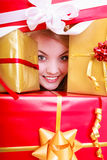 Happy cheerful girl with many christmas gift boxes. Holiday. Royalty Free Stock Photos