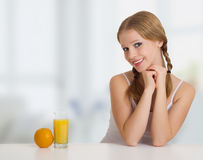 Happy cheerful girl with orange juice. Portrait of beautiful happy cheerful girl with orange juice royalty free stock photography
