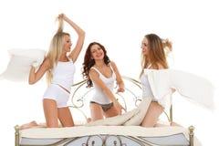 Happy cheerful girls. Pyjamas party. royalty free stock photo