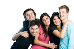 Happy cheerful group of friends. Happy smiling group of young friends standing and embracing together isolated on white background with copy space Stock Photo