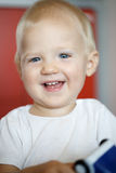 Happy and cheerful little toddler, playing and having fun Stock Photo