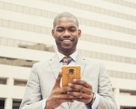 Happy, cheerful man excited by what he sees on cell phone Stock Photos
