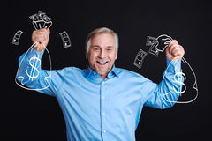 Happy cheerful man holding bags with money Stock Photo
