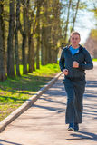 Happy cheerful man running   in the park Royalty Free Stock Photography