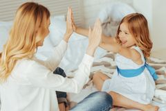 Happy cheerful mother and daughter having fun Stock Images