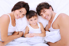 Happy cheerful parents with little boy Stock Photography