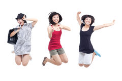 Happy, cheerful, playful chinese youths jumpy. Happy, cheerful, playful Chinese youths holding hands and jumping for joy Royalty Free Stock Images