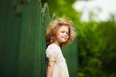 Happy, cheerful and shaggy little girl Stock Image