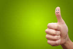 Happy cheerful smiley finger on green background Royalty Free Stock Photography