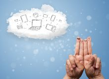 Happy smiley fingers looking at cloud computing with technology icons. Happy cheerful smiley fingers looking at cloud computing with technology icons Stock Photos