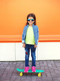 Happy cheerful smiling stylish little girl child with skateboard Royalty Free Stock Photos