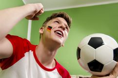 Happy cheerful teen, holding soccer ball royalty free stock photography