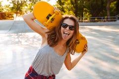 Happy cheerful woman walking outdoors stock photos