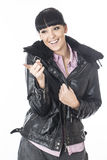 Happy Cheerful Young Attractive Woman Pointing and Laughing. Happy cheerful Young attractive Woman with black hair, and hispanic or european features, looking Stock Image