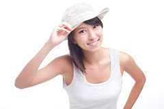 Happy cheerful young Chinese woman salutes, greets. Happy, cheerful young chinese woman with white hat Stock Image
