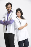 Happy cheerful young Indian attractive doctors Royalty Free Stock Photos