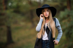 Happy cheerful young woman in black hat outdoor. Royalty Free Stock Images