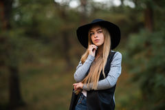 Happy cheerful young woman in black hat outdoor. Royalty Free Stock Photo