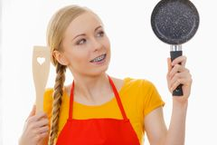 Woman holding cooking pan and spatula Royalty Free Stock Photography