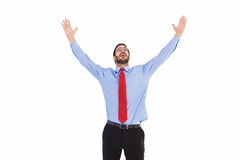Happy cheering businessman raising his arms Stock Photos
