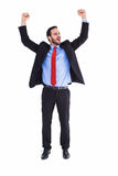 Happy cheering businessman raising his arms Royalty Free Stock Photos