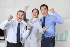 Happy cheering businesspeople. Three happy cheering businesspeople with clenched fists in the offce Royalty Free Stock Images