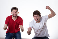 Happy cheering men Stock Photo