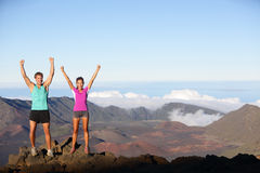 Happy cheering winning success outdoors couple. Excited having reached summit of mountain volcano , East Maui Volcano, Hawaii. Young multiracial sporty fitness Stock Photography