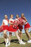 Happy Cheerleaders On Field Royalty Free Stock Photography