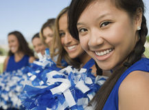 Happy Cheerleaders In A Row Stock Photo