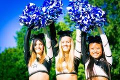 Happy Cheerleading Team. A team of pretty cheerleaders Stock Images