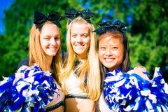Happy Cheerleading Team. A team of pretty, female cheerleaders having fun outdoors Royalty Free Stock Image