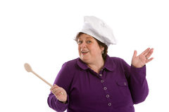 Happy chef. Middle aged woman waving her wooden spoon on white background Royalty Free Stock Images