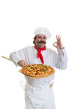Happy Chef Approval. Italian Chef holding a pizza on a peel showing his approval Stock Images