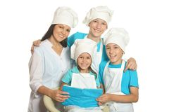 Happy chef with assistants. Happy female chef with assistants isolated on a white background royalty free stock images