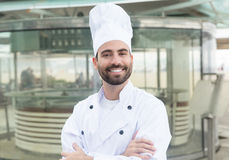 Happy chef with beard in front of a restaurant Royalty Free Stock Images