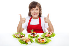 Happy chef boy with creative sandwiches Royalty Free Stock Photos