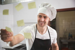 Happy chef checking out orders Royalty Free Stock Photo