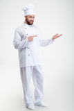 Happy chef cook holding copyspace on the palm Royalty Free Stock Photo
