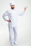 Happy chef cook showing welcome gesture Royalty Free Stock Photos