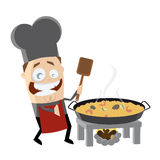 Happy chef cooking Spanish paella Royalty Free Stock Photography