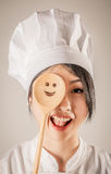 Happy Chef Covering One Eye with Wooden Ladle Stock Photo