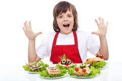 Happy chef with creative food creature sandwiches Royalty Free Stock Photography
