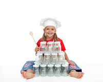 Happy chef girl with jars for canning Stock Photo