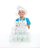 Happy chef girl with lots of jars for canning Royalty Free Stock Images