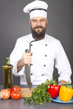 Happy chef holding a big sharp knife on a board ready to cook Royalty Free Stock Photo