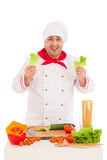 Happy chef holding leaf of salad and cooking with fresh vegetabl Royalty Free Stock Photography